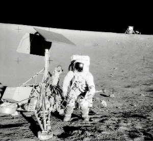Surveyor 3 with Apollo 12 Lunar Module in background. (Source: wikipedia)