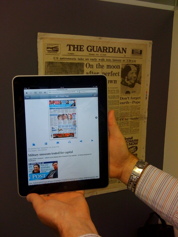 The old and the new. The Guardian's front page detailing the 1969 Apollo 11 moon landing behind the Dominion Post featured on the tablet via Press Display