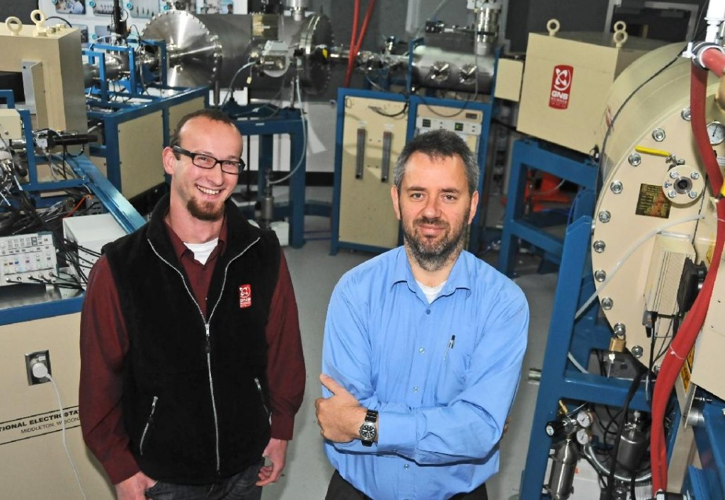 Caption:  Scientists Johannes Kaiser (left) and Albert Zondervan with the new $3.4 million accelerator mass spectrometry facility at GNS Science's National Isotope Centre in Lower Hutt. It is the only facility of its type in the Southern Hemisphere and its applications include climate resaearch, archaeology, oceanography, geology, earthquake and volcano research, marine biology, and dating antiquities. Photo - Margaret Low, GNS Science