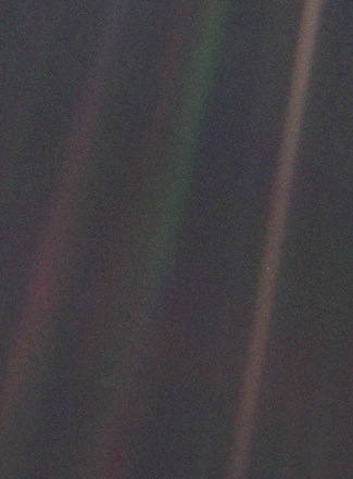 Pale blue dot - the earth from 6.1 billion kilometres (Source: Wikimedia Commons.)