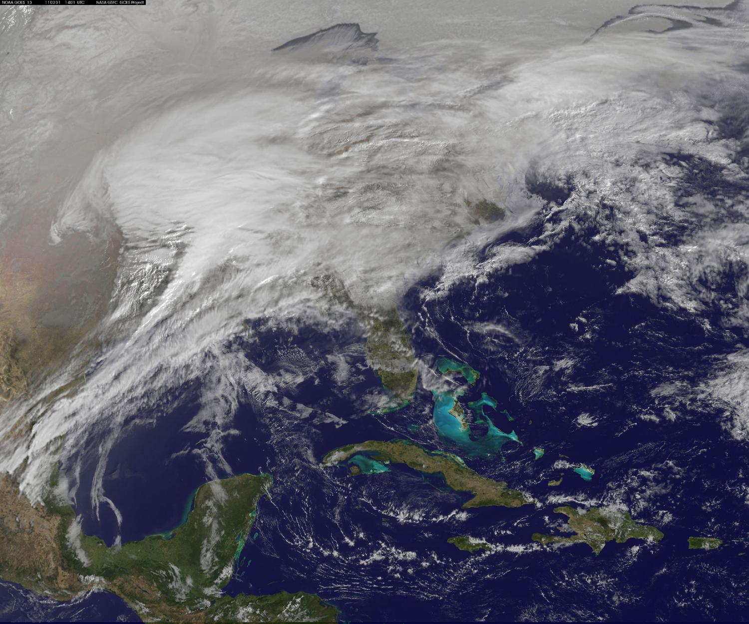 This visible image was captured by the GOES-13 satellite and shows the low pressure area stretching from the Colorado Rockies and Texas east to New England. The image shows the storm on Feb. 1 at 1401 UTC (9:01 a.m. EST) by the NASA GOES Project, located at NASA's Goddard Space Flight Center in Greenbelt, Md. The GOES series of satellites are operated by NOAA.  Credit: NOAA/NASA GOES Project