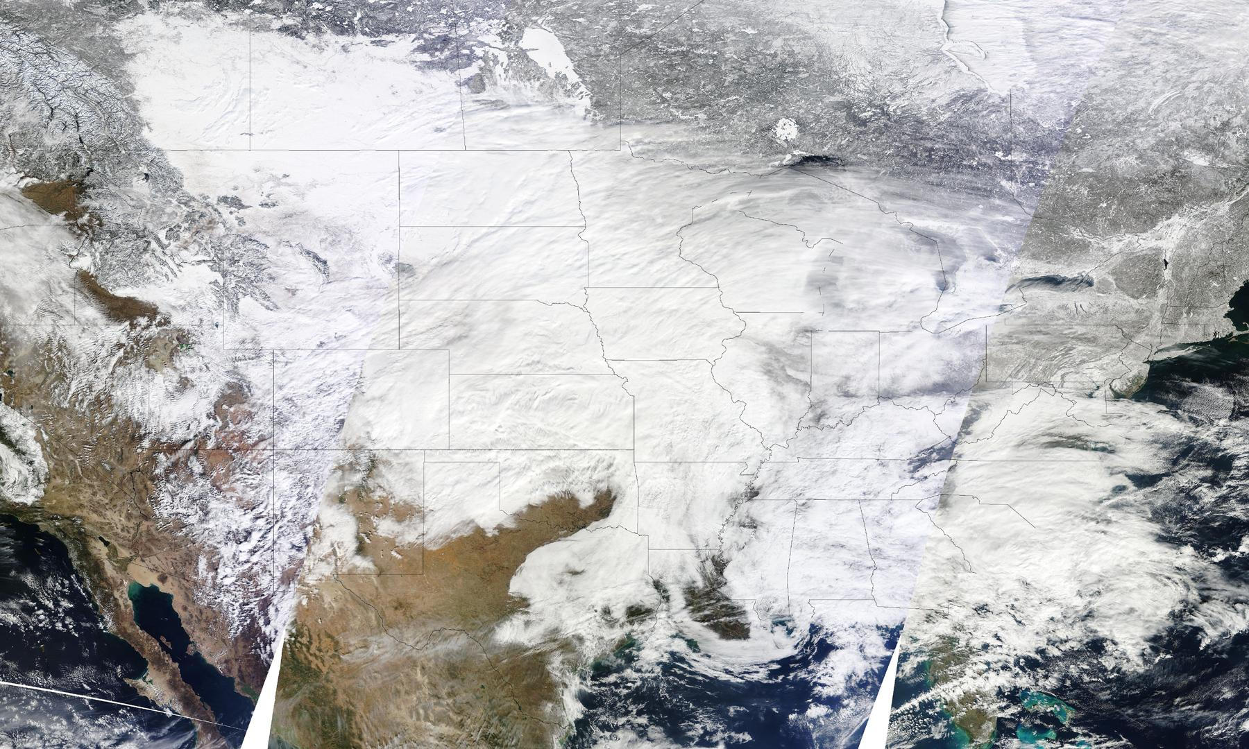Three images from the Moderate Resolution Imaging Spectroradiometer (MODIS) aboard NASA's Terra satellite were combined to create this image of the storm system. The images were captured on Jan. 31 at 10:30 a.m., 12:05 p.m., and 1:45 p.m. ET (15:30, 17:05, and 18:45 UTC). Diagonal lines across the image show the boundaries between the overpasses. White gaps are areas where the sensor did not collect data. The image has a resolution of one kilometer per pixel. Credit: NASA Goddard MODIS Rapid Response Team