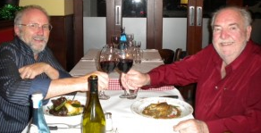 John Nixon (right) dining with telecommunications analyst Paul Budde.
