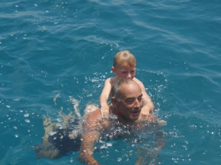 Peter enjoying a swim in clean waters with family