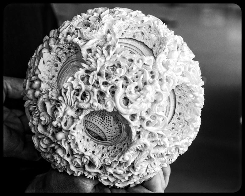 This ball had 56 layers and took 3 years to carve.  It was in a legal, registered seller's store in Fuzhou