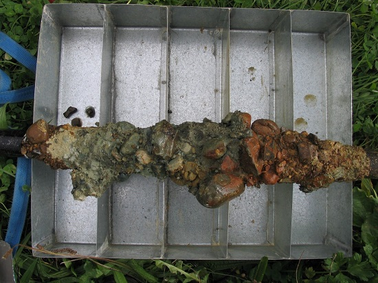 Frozen material attached to stand pipe.