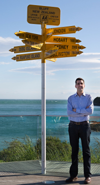 Dr Michael Stevens at the Bluff signpost to the world.