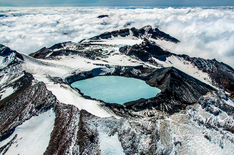 View of the crater lake atop New Zealandís largest active volcano ñ Mt Ruapehu. If you look closely, steam can be seen above the warm crater lake surface. Caption: Nava Fedaeff
