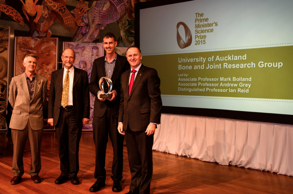 Andrew Grey, Ian Reid and Mark Bolland (from left) being awarded the 2015 Prime Minister's Science Prize for this research by John Key on November 11 in Wellington. Credit: Mark Tantrum. http://www.pmscienceprizes.org.nz/2015-prime-ministers-science-prize-winner/