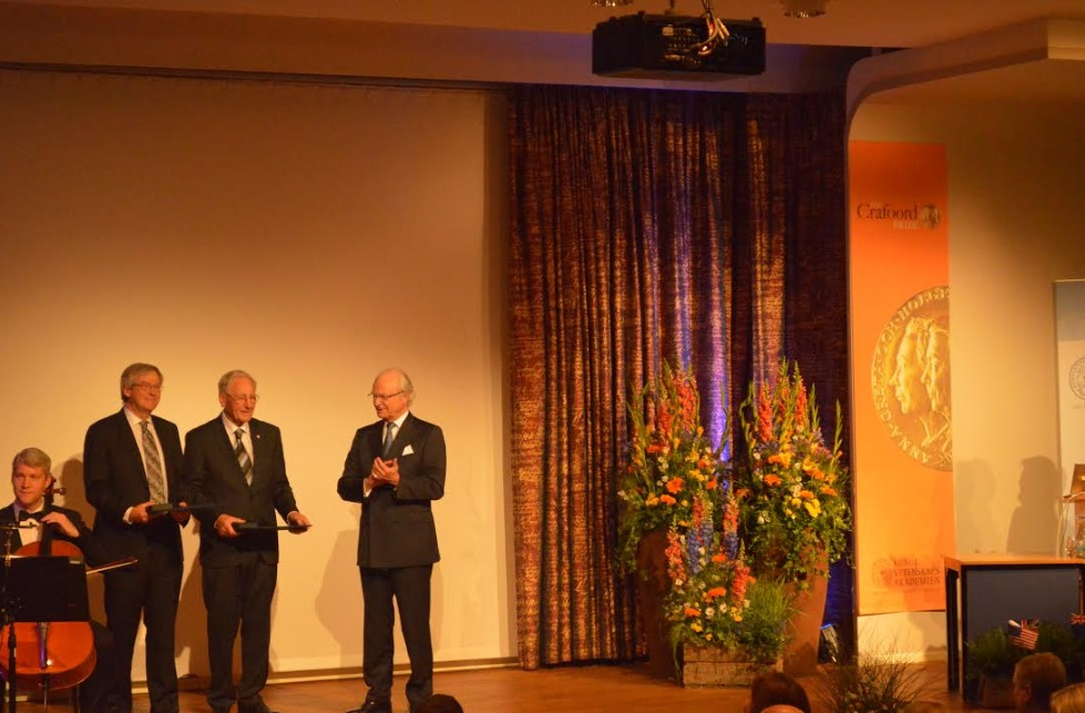 Roy Kerr (left) and Roger Blandford receive the Crafoord Prize from the King of Sweden in Stockholm today. Photo: Laura Pishief