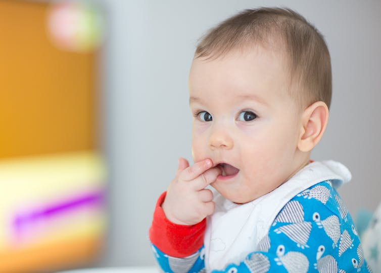 Featured image: Babies can learn the value of persistence by watching grownups stick with a challenge